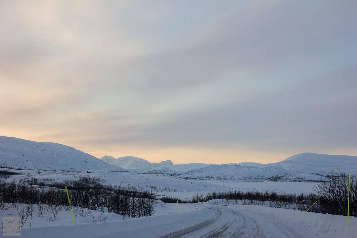 Lapland sunset winter road