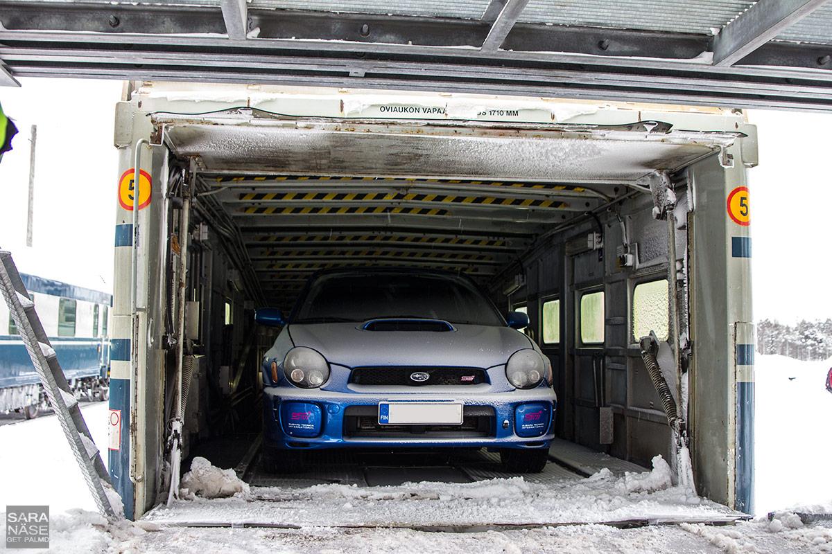 Snowy Subaru on car train