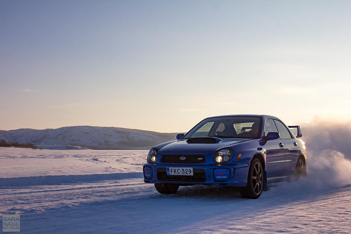 Blue Subaru Impreza drifting