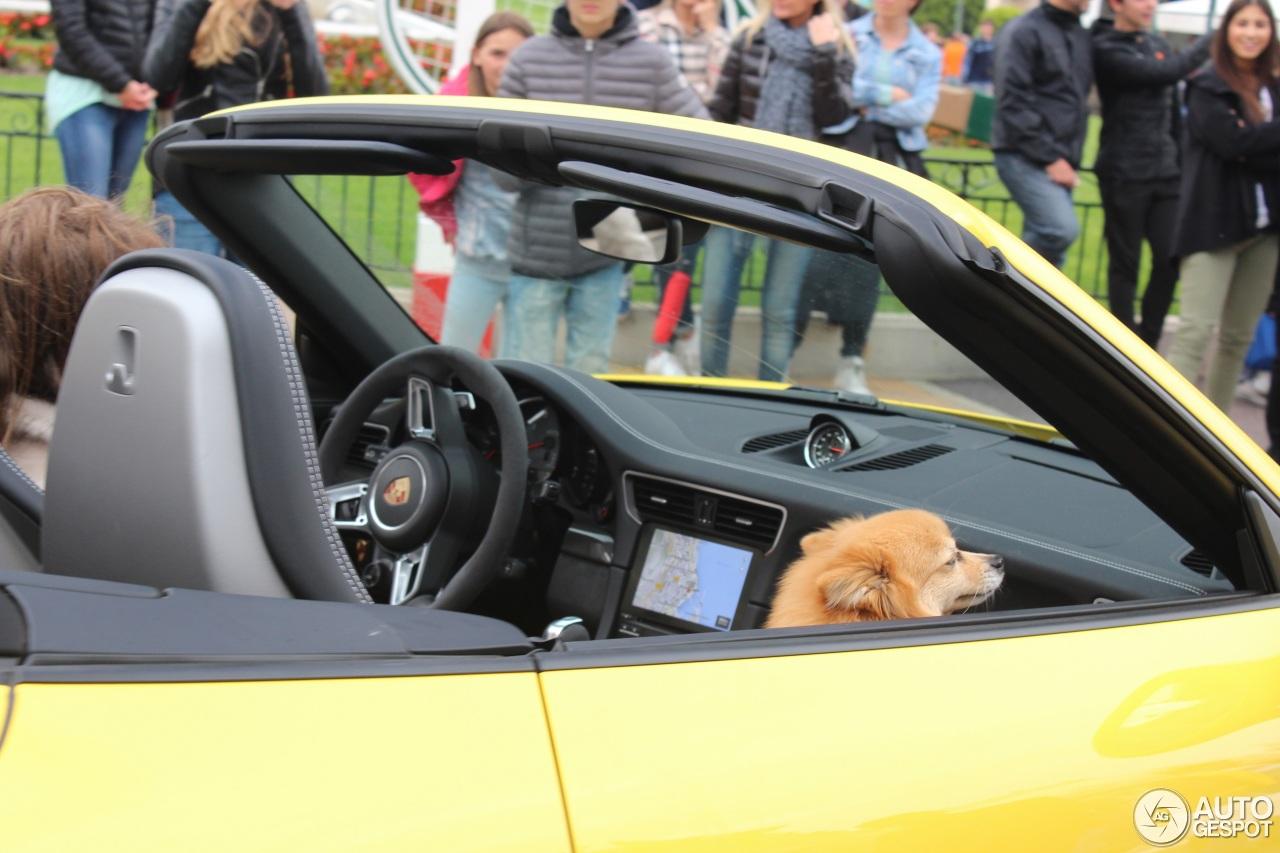 Top Marques Monaco 2017 - Racing yellow Porsche 911 Carrera 4 GTS Cabriolet and dog